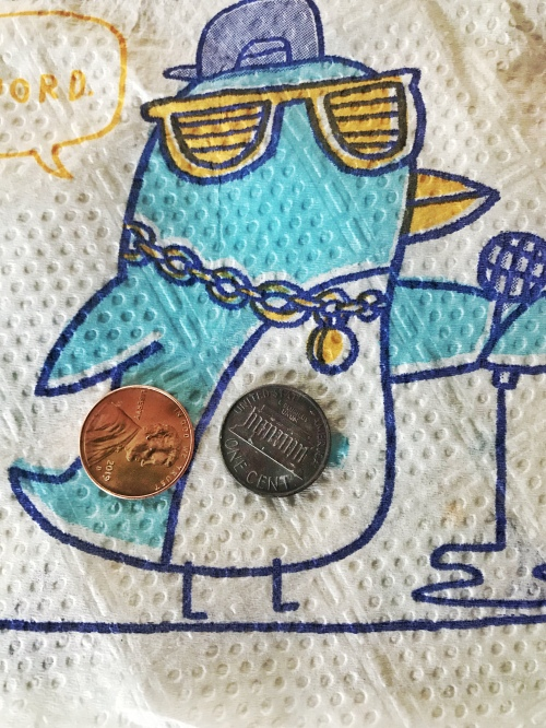Napkin and two pennies.