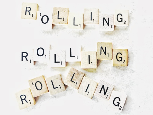 Rolling spelled 3 times in scrabble tiles