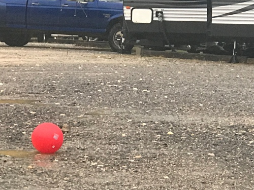 Red ball in the driveway