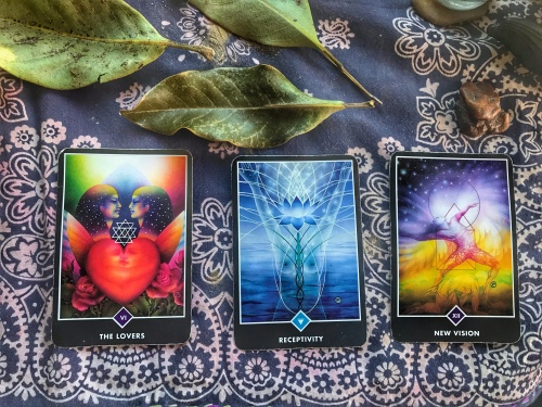 Tarot cards: The Lovers, Receptivity, New Vision. They are laying on my home altar.